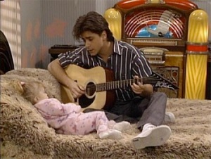 Who can resist a dude serenading a toddler?
