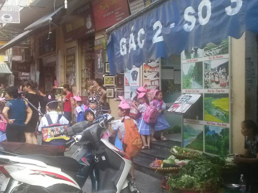 Some kids in funny uniforms and hats. I saw them on another day in Hanoi, but I wanted to stick a photo here.
